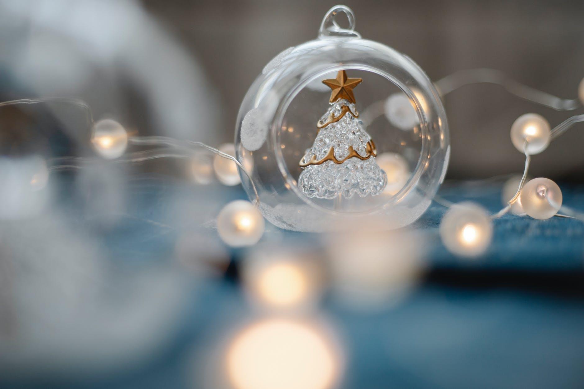 glass ball with decorative christmas tree