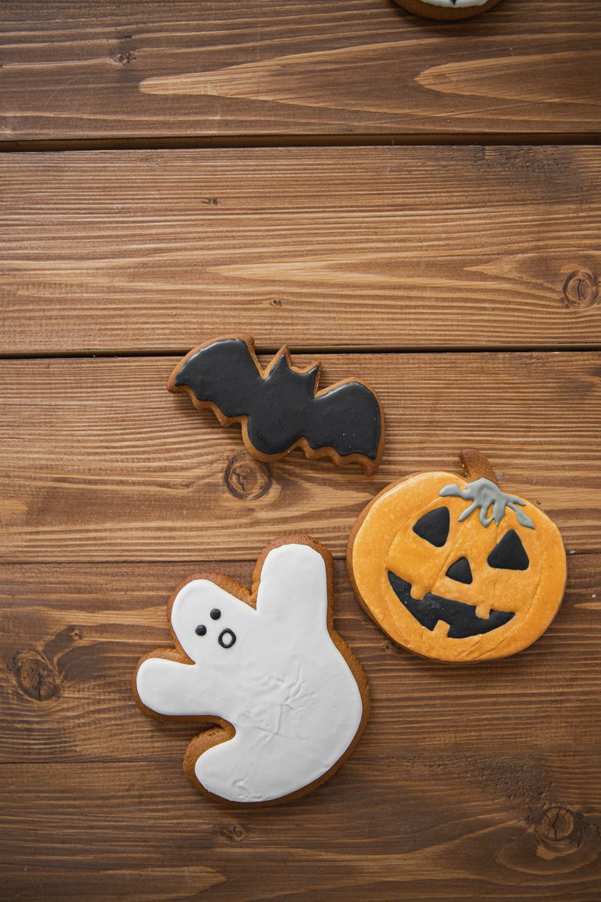 halloween cookies on wooden surface
