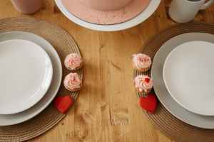 top view shot of a diner table with ceramic plates and cups
