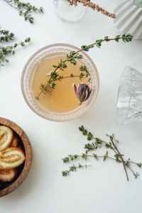 clear glass bowl with herbs and tea