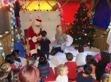 Santa visits children at Nursery Rhymes