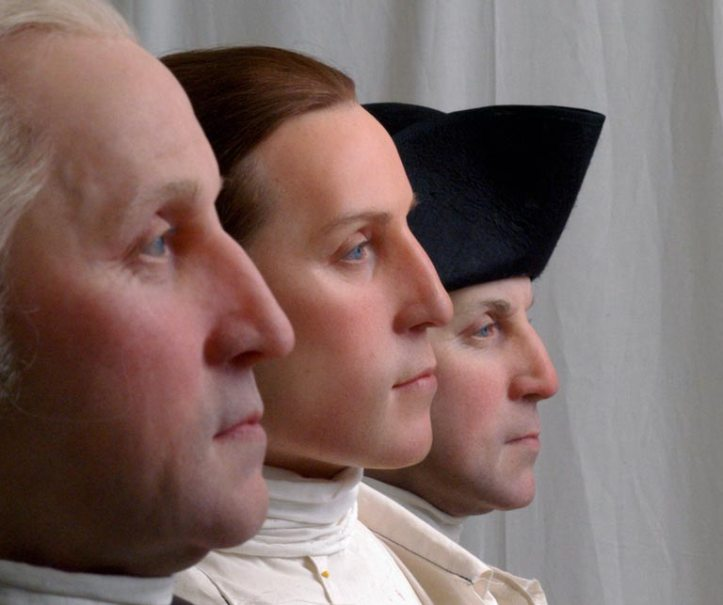 The forensically reconstructed faces of George Washington at ages 19, 45, and 57, on display at the Mt. Vernon Education Center.
