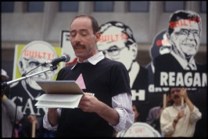 Vito Russo at the 1988 ACT-UP protests. His forceful 'Why We Fight' speech called out government and medical neglect in the face of HIV/AIDS. (Source: Unfinished Lives)