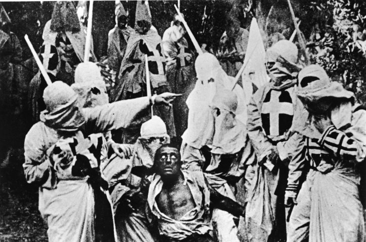 Film still from The Birth of a Nation with actors dressed as Ku Klux Klan members.