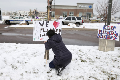 Signs in support of Planned Parenthood just south of its Colorado Springs clinic, November 29, 2015. (David Zalubowski/AP)