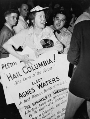 Agnes Waters carrying placard announcing her plans to run for President of the United States and trying to take the floor at the 1948 Democratic National Convention, shortly before she was escorted out by convention guards. (New York World-Telegram and the Sun Newspaper Photograph Collection/Library of Congress)
