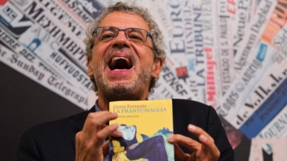 Journalist Claudio Gatti with a copy of Elena Ferrante's La Frantumaglia. (Domenico Stinellis/AP)