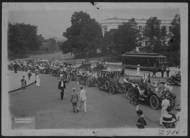 Line of early automobiles in a procession in Washington DC, 1913.