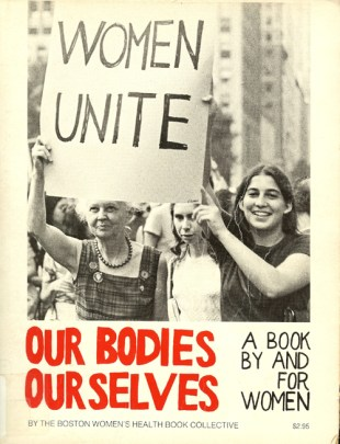 Women in a crowd hold up a sign that says WOMEN UNITE, and Our Bodies, Ourselves is written in red across the bottom.