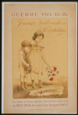 A drawing of a girl and boy standing over a grave, dropping flowers on it.
