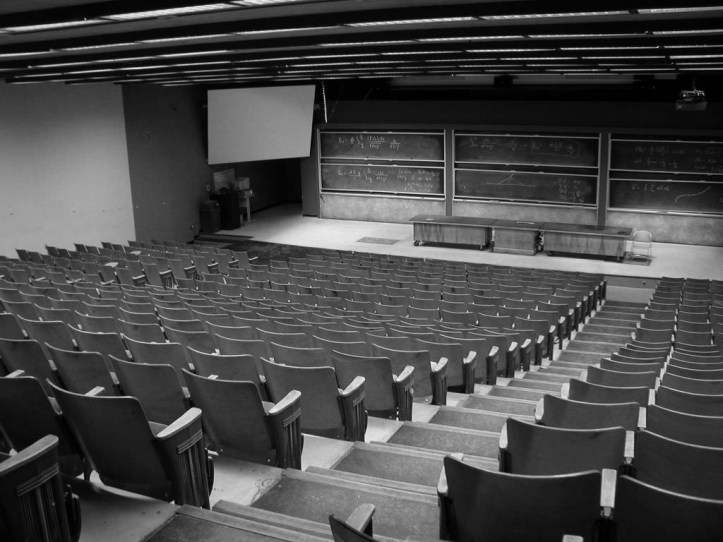 A large empty lecture hall with tiers of seats.