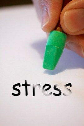 "Someone is holding a pencil's eraser over the word ""stress"" which has been slightly erased"