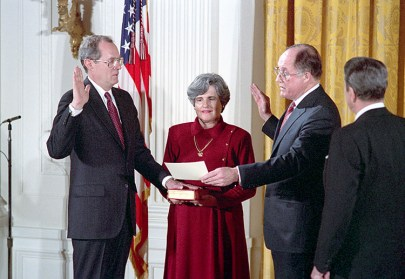 President Reagan, Anthony Kennedy, Mary Kennedy and William Rehnquist at the swearing in ceremony for Judge Anthony Kennedy as Associate Justice of the United States Supreme Court in the East Room.