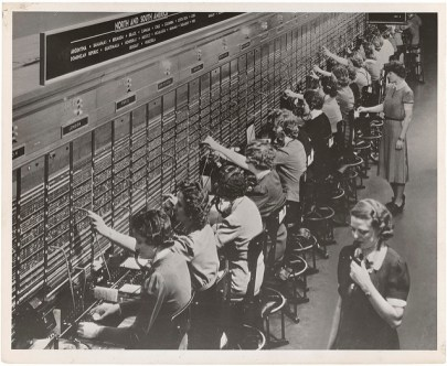 A line of women sitting at a switchboard.