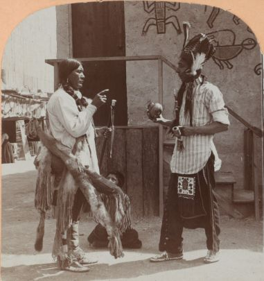 Two men in American Indian attire.