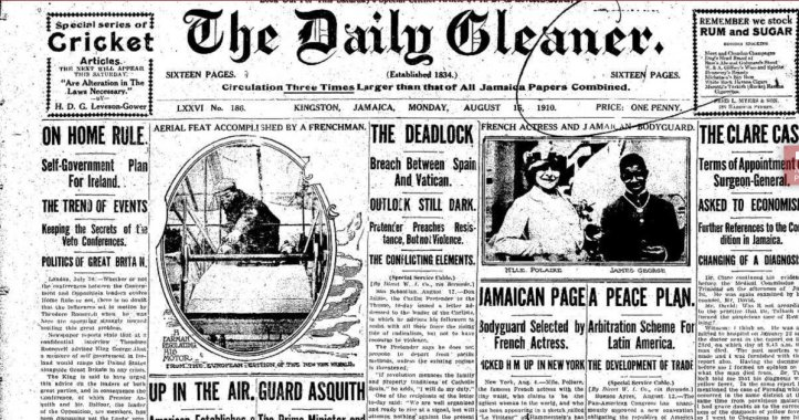 """The front page of a 1910 newspaper titled The Daily Gleaner with a headline story titled """"Jamaican Page, Bodyguard selected by French actress"""" with a grainy photo of a light-skinned woman and a dark-skinned man standing next to each other."""