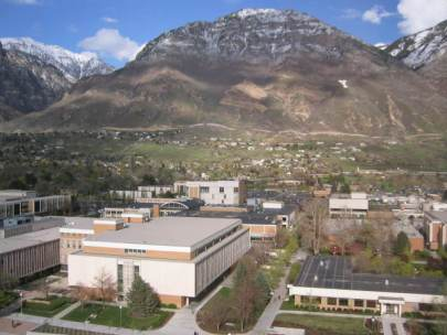 Landscape photo of the BYU campus in Provo, Utah, with a tall mountain the background.