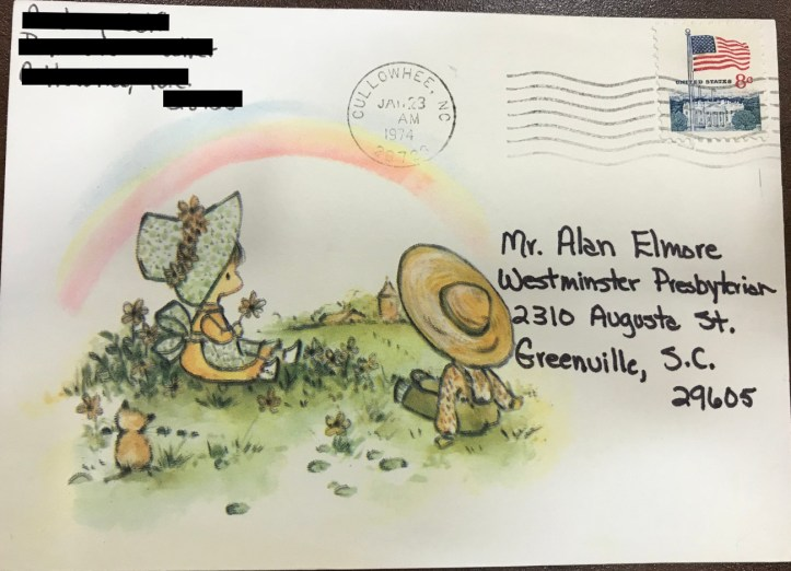 The front of a postcard with an illustration of two stylized children in bonnets sitting in a field under a rainbow.