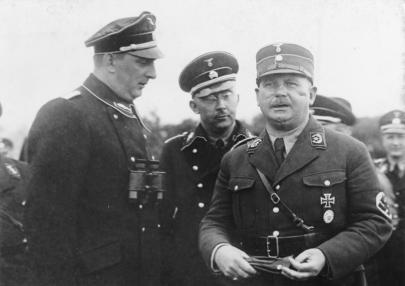 Three German military commanders - Rohm, Himmler, and Daleuge - stand together in full military dress
