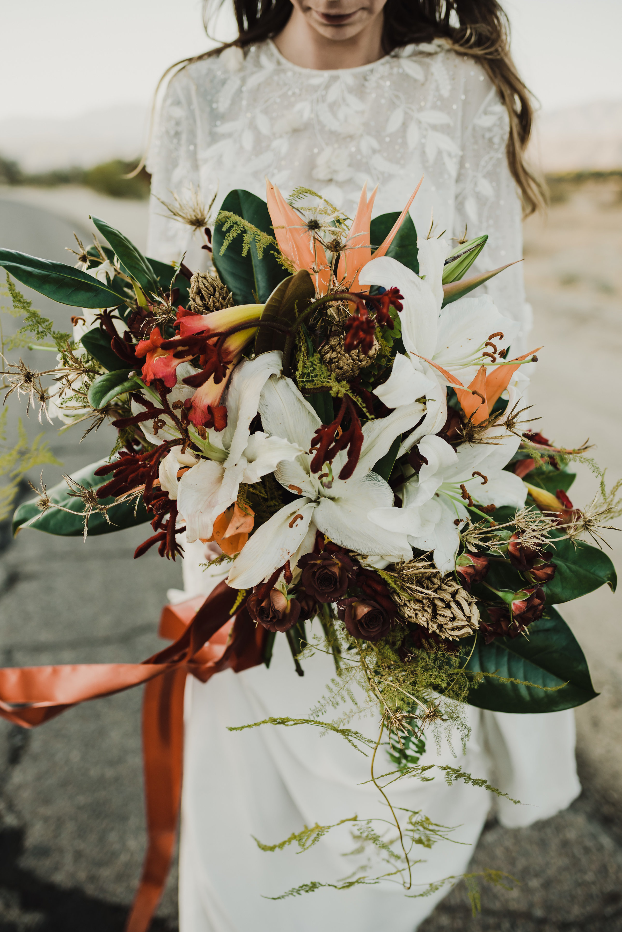 This boho desert wedding inspiration = an old school western film + a real pretty dress + perfectly rusty metal monsters.