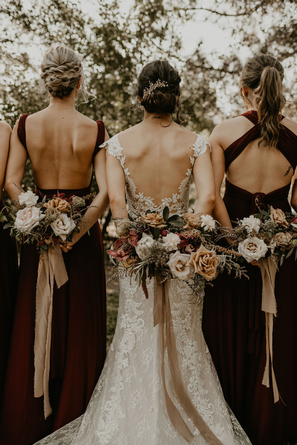 Boho Rustic wedding inspiration with texture, dried, neutral tones with lush foliage and maroon orchids.