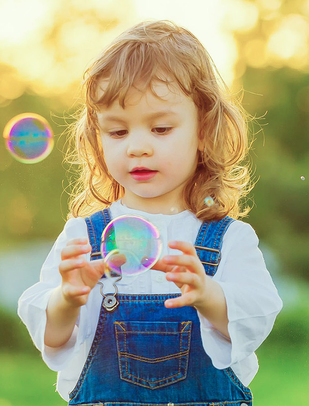 happy-children-playing-with-soap-bubbles-on-a-summer-nature-bubbles-in-the-sunset-focus