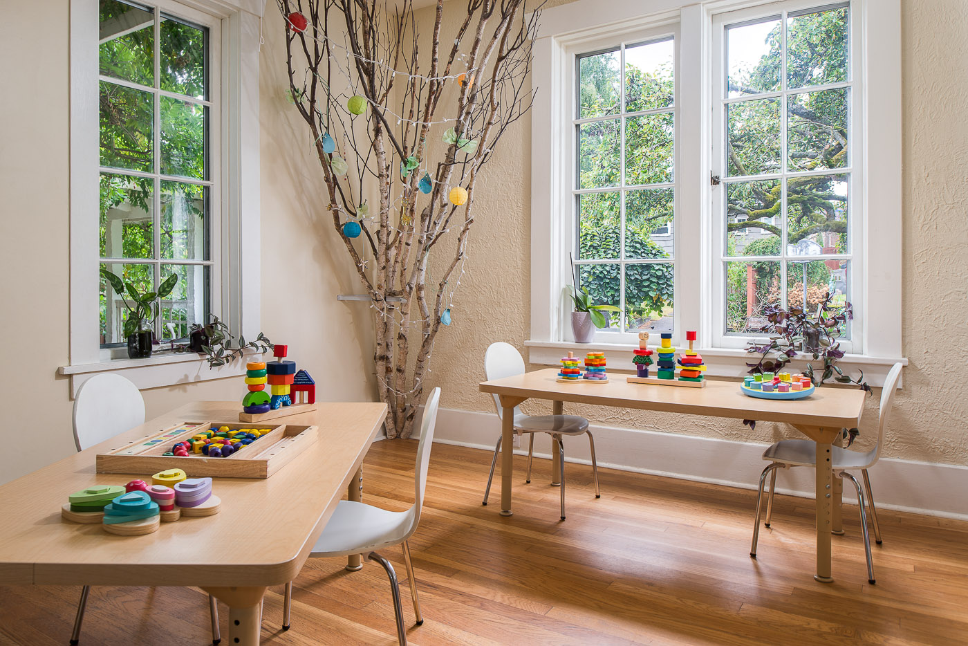 Preschool Room with birch logs, kids crafts and toys