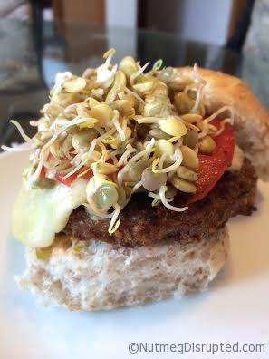 Fresnhly sprouted lentils on a grilled burger in the Nutmeg Disrupted kitchen