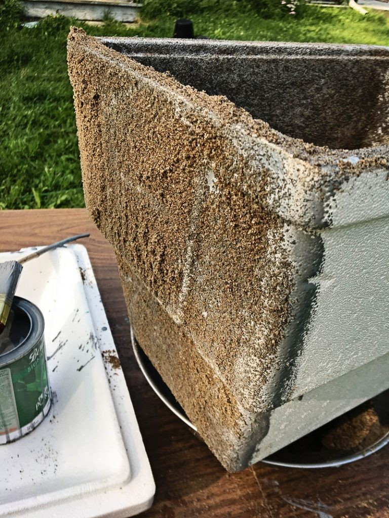 The first coat in creating a faux stone planter on Nutmeg Disrupted