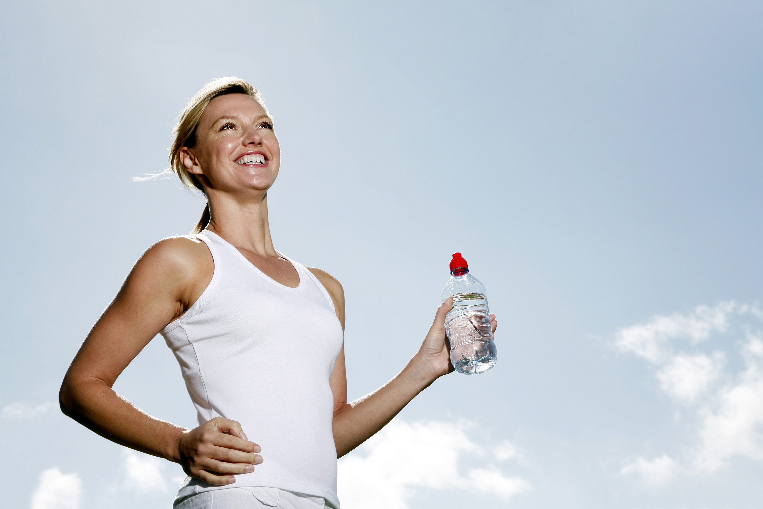 woman-running-with-water-bottle-in-hand