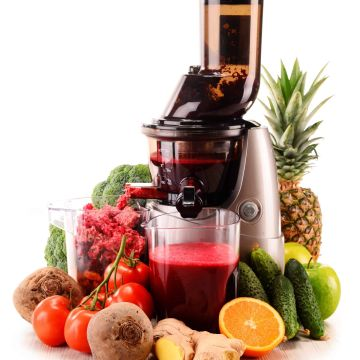 Slow juicer with organic fruits and vegetables