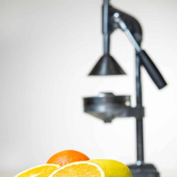 Commercial Citrus juicer with oranges
