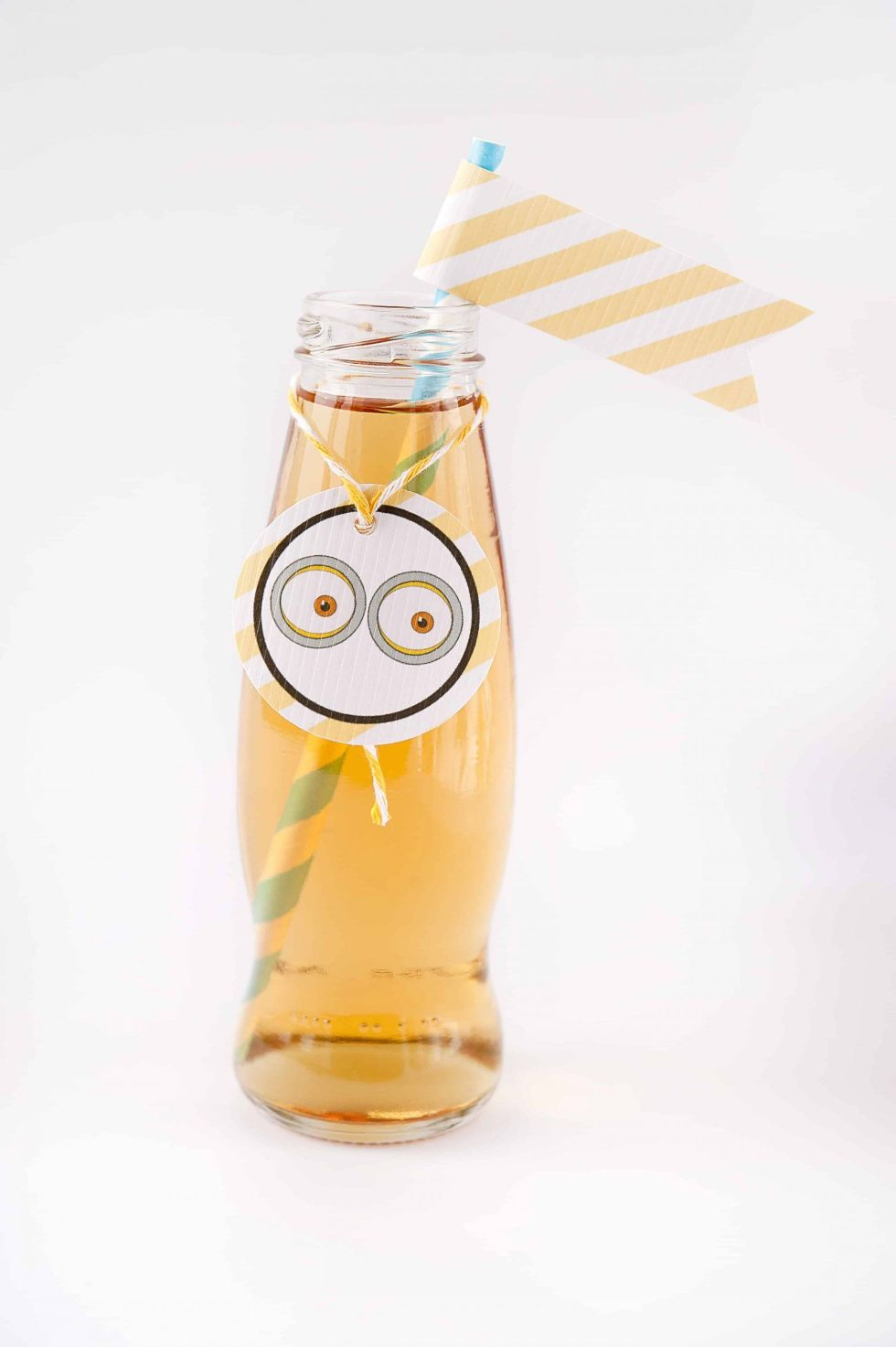 apple juice in a beautiful bottle with eyes and a flag and decorations