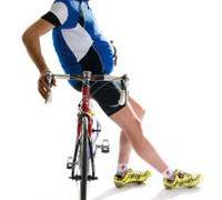 overweight cyclist holding belly