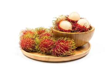 Rambutan: Purple Hairy Fruit With Soft White Fruit Inside.