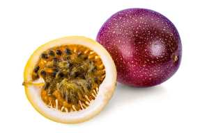 Whole Passion Fruit and Half Passion Fruit Showing Orange Flesh.