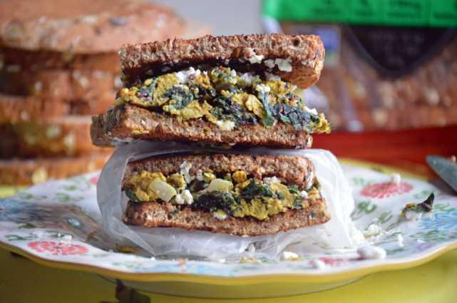 Turmeric Egg Sandwich with Swiss Chard & Feta on Dave's Killer Bread