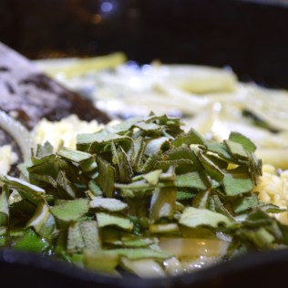 Add garlic and sage