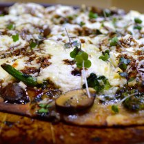 Pizza with Broccoli Rabe, Garlic, Mushrooms & Golden Raisins