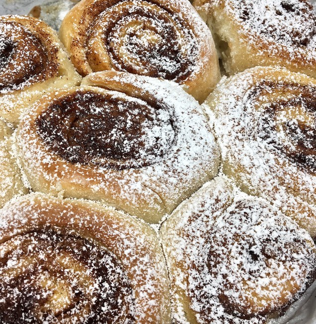 Cooked Sourdough Cinnamon Rolls Dusted w:Powdered Sugar