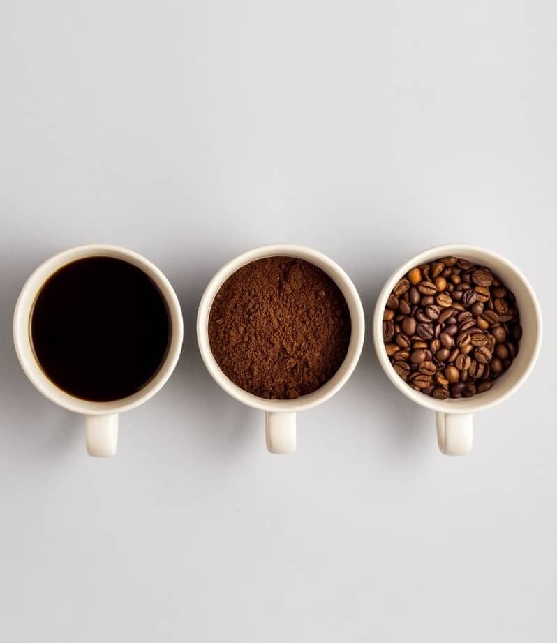 3 mugs of coffee; coffee beans, ground coffee and brewed coffee