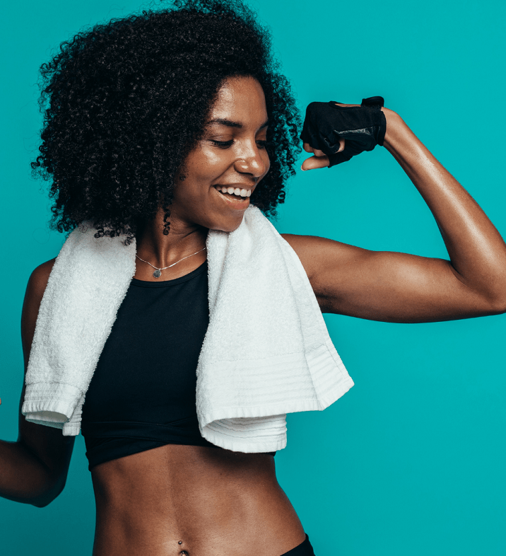 woman showing muscle with white exercise towel