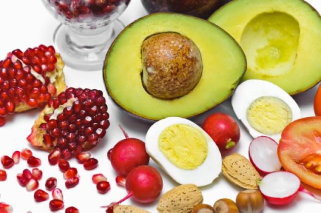 Pome Granate, avocado, egg, radish, nut, tomatoes isolated on white background