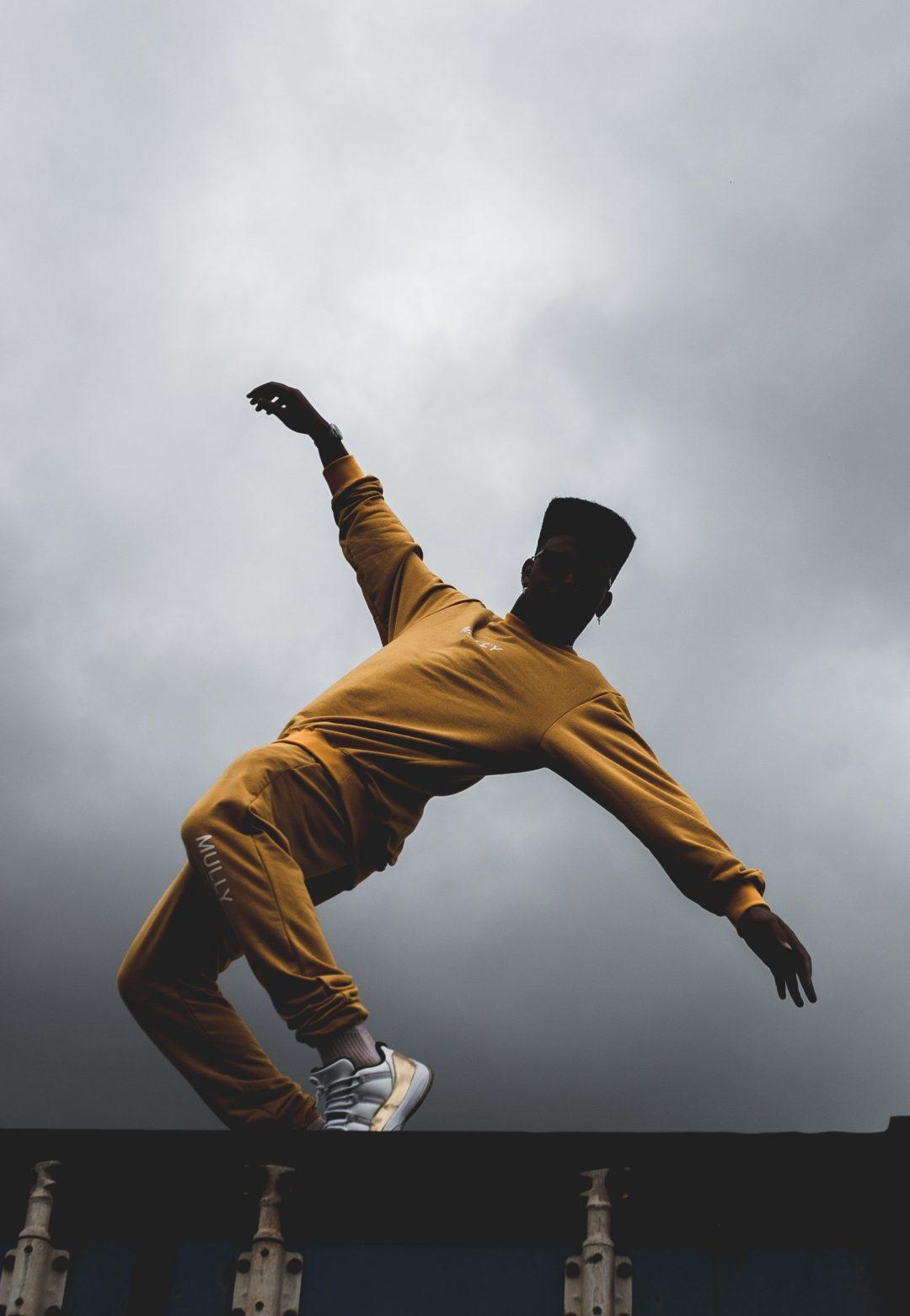 Man Balancing On Wal