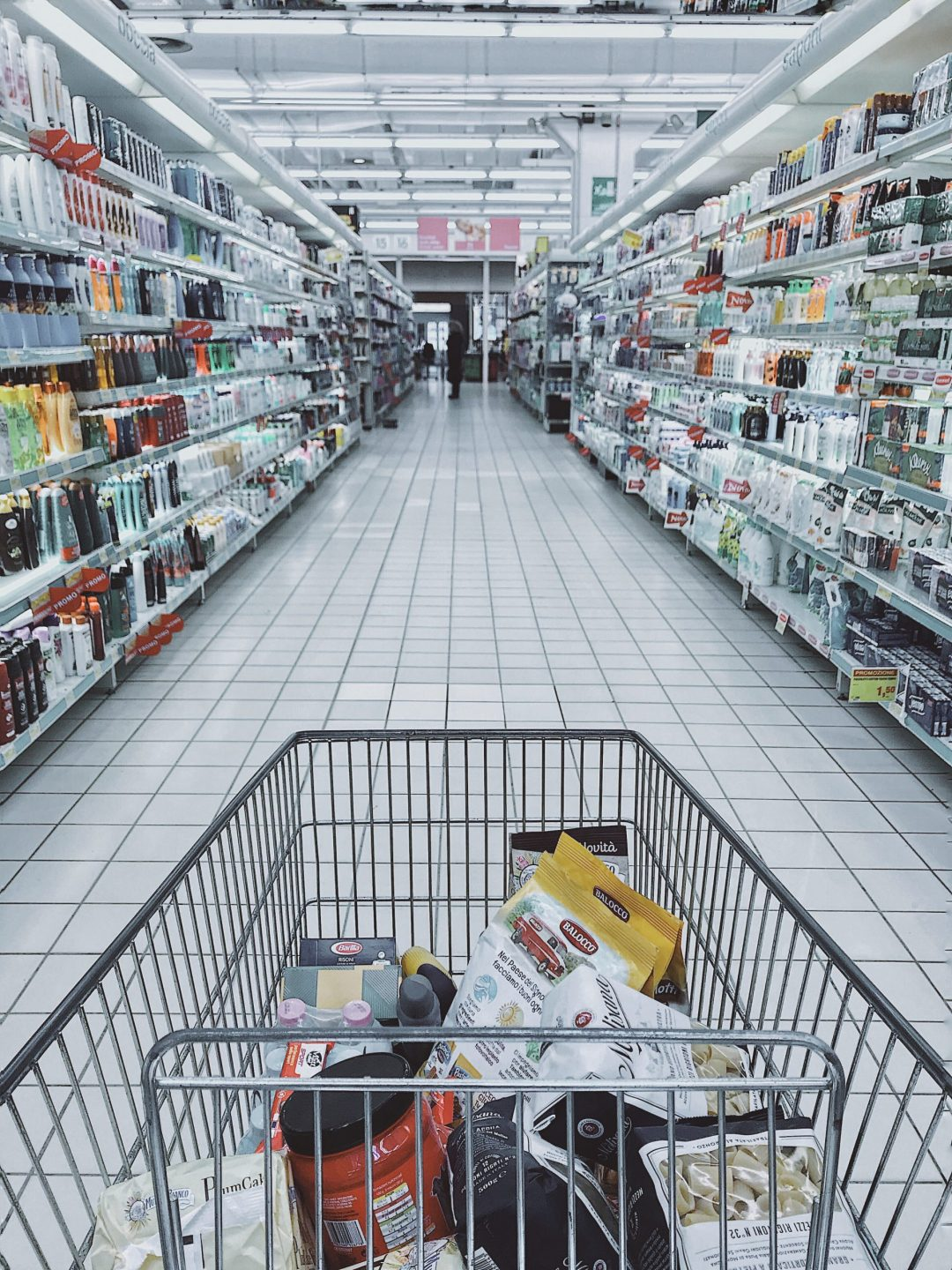 shopping cart in supermarket aisle