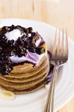 raw pancakes with blueberry sauce and whipped cream