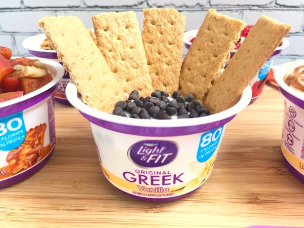 Vanilla Greek yogurt cup with graham crackers and chocolate chips