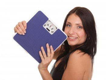 Woman with scale, weight loss concept