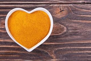 Turmeric powder in a heart shaped dish