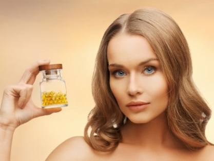 Woman with vitamin D bottle